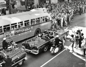 """November 22, 1963. """"Overview of crowds of people waving as President John F. Kennedy and his wife sit in back of limousine during procession through downtown Dallas, Texas"""" from the New York World-Telegram and the Sun Newspaper Photograph Collection, Library of Congress"""